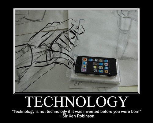 """poster with a charcoal drawn hand reaching for a smartphone placed on top of the drawing. Text underneath says """"Technology is not technology it it was invented before you were born"""" ~ Sir Ken Robinson"""